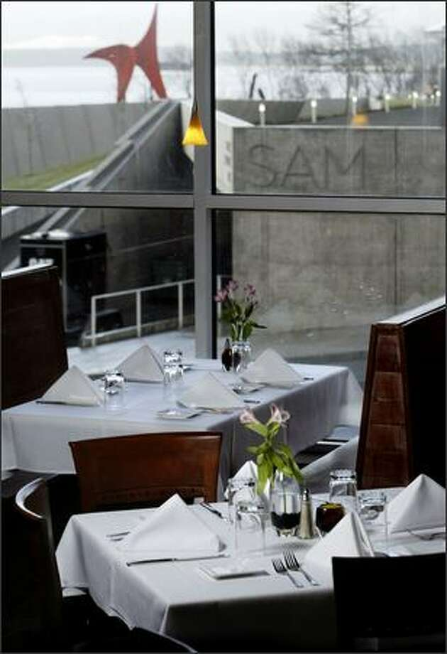 The Cucina De-Ra dining room offers views of the new Olympic Sculpture Park and the Space Needle. Photo: ANDY ROGERS/P-I
