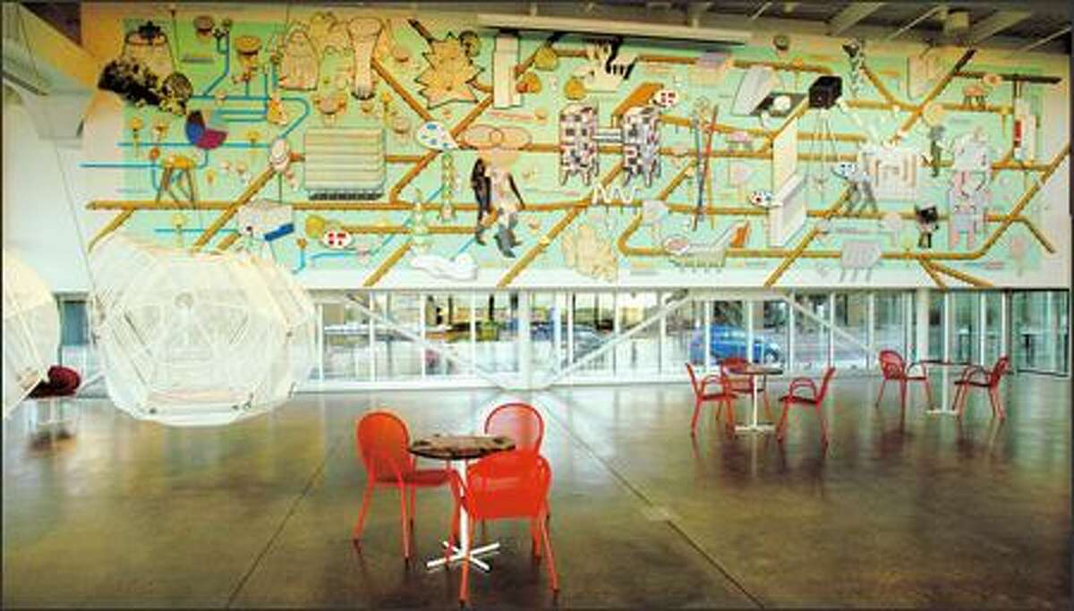 """Pedro Reyes' hanging cages """"Capula XVI and XVII"""" and """"Evolving City Wall Mural"""" can be studied from cafe seats. The menu will promote local, organic and sustainable dining."""