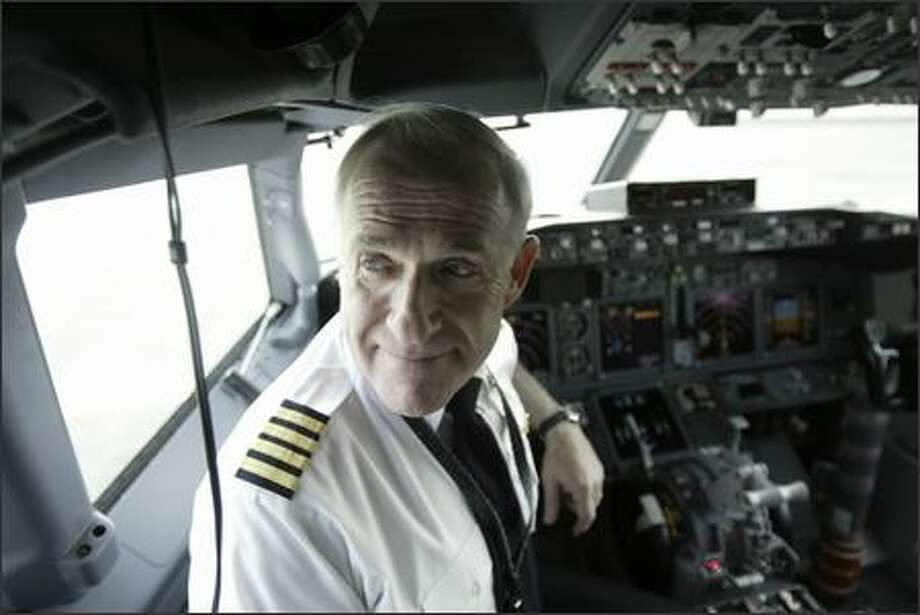 John Cashman, Boeing's chief test pilot and director of flight operations, is retiring at the end of the month. Appropriately enough, his retirement party tonight will be at the Museum of Flight. Cashman is shown here in the cockpit of a 737-900 earlier this week. Photo: Andy Rogers/Seattle Post-Intelligencer