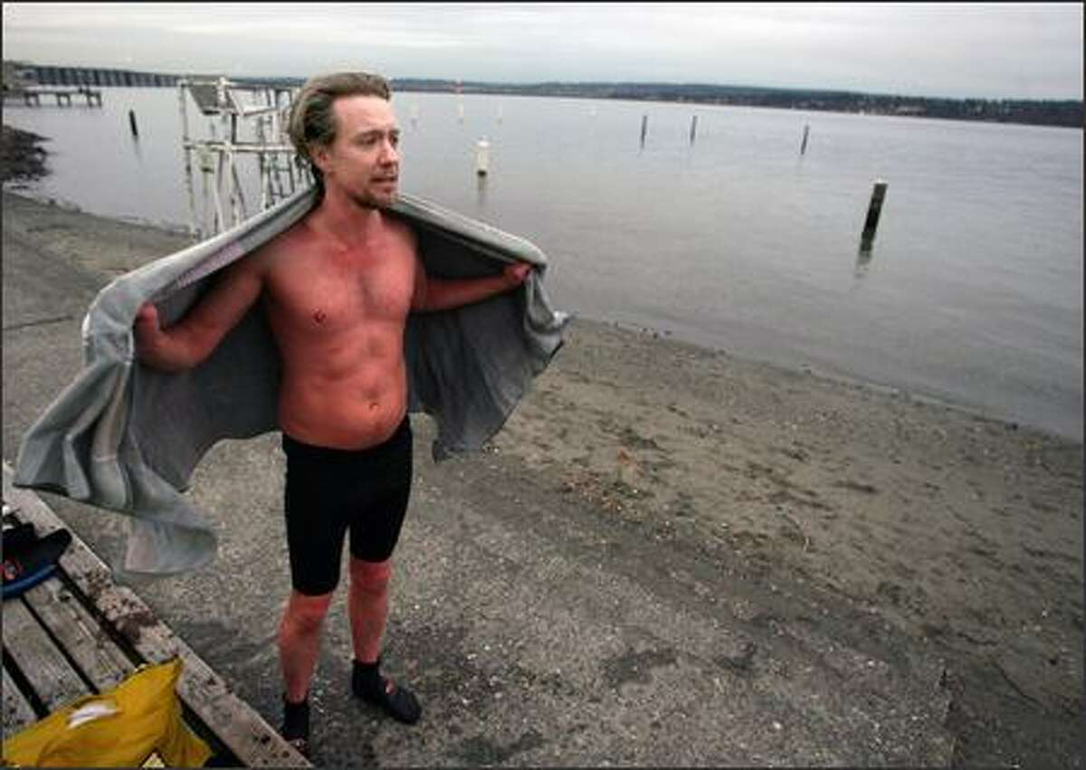 Michael Sullivan has been swimming in Lake Washington every day since June -- over 200 consecutive days. Here he towels off after his swim on Monday, a swim that, as usually happens in the frigid waters, turned his skin red.