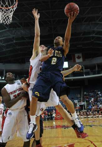 Kent State's Michael Porrini shoots with the left hand against Fairfield's Ryan Olander during their second round NIT matchup at the Webster Bank Arena at Harbor Yard in Bridgeport, Connecticut on Sunday, March 20, 2011. Photo: Brian A. Pounds / Connecticut Post