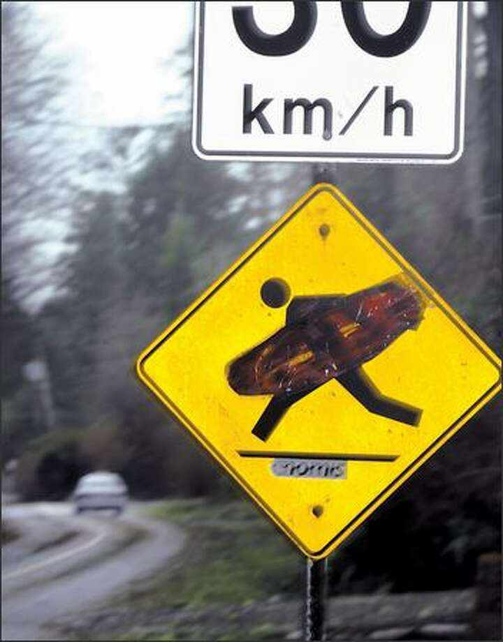 A street sign reflects the surfing culture of Tofino, B.C. Photo: KAREN DUCEY/P-I