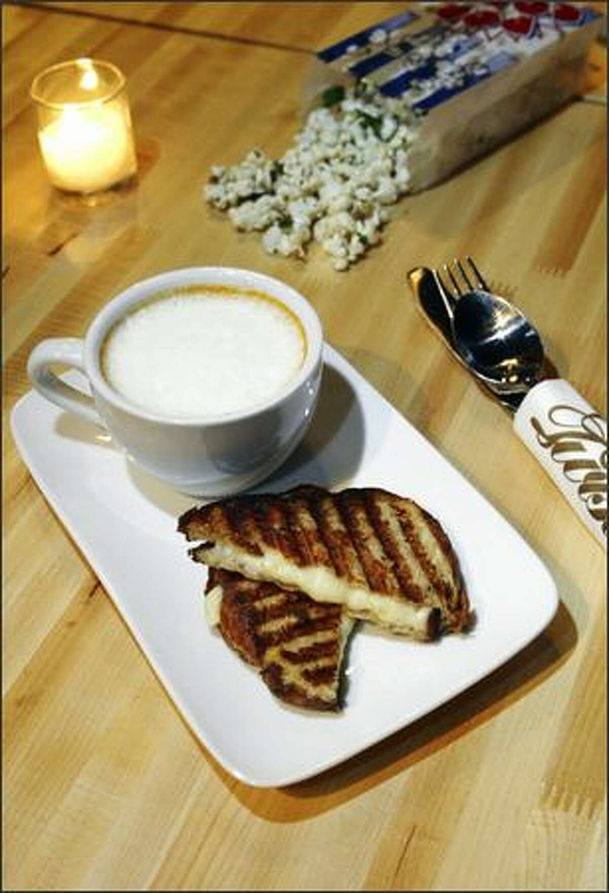 Tomato Cappuccino at Oliver's Twist is a creamy homemade soup served with a grilled cheese on toasted brioche.