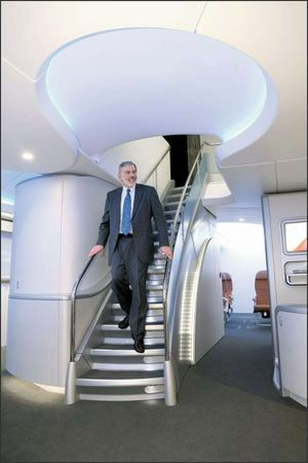 Klaus Brauer, director of passenger satisfaction and revenue, says airlines have been impressed with the life-size mock-up of the user-friendly interior of Boeing's new 747-8 Intercontinental. Photo: Grant M. Haller/Seattle Post-Intelligencer