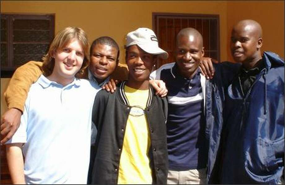 UW graduate student Bion Bliss, far left, with colleagues in South Africa, where he served in the Peace Corps. Bliss worked on HIV and AIDS testing and prevention projects during his two years there. Photo: Peace Corps