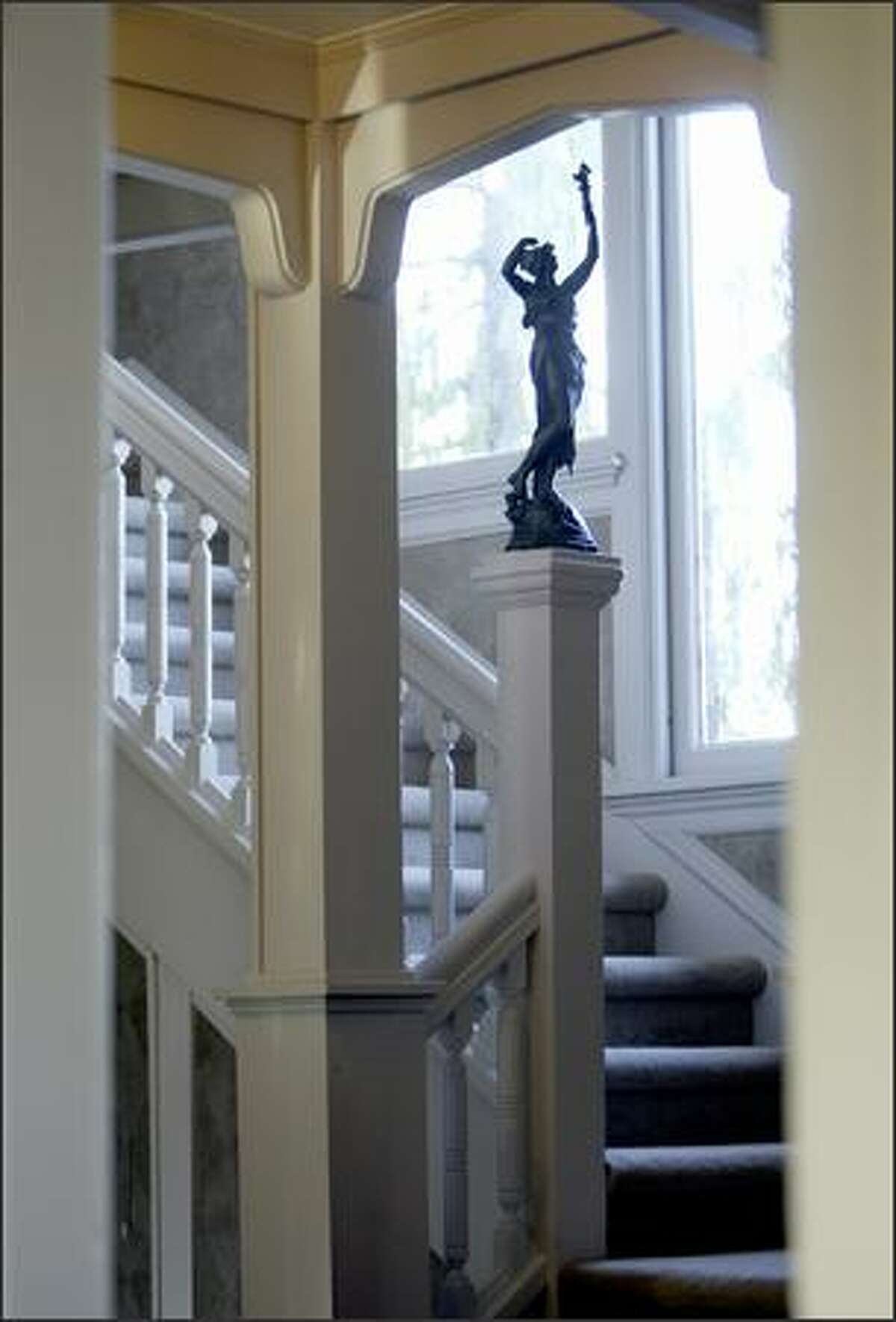 Sculpture graces the stairwell to the second floor of the Hainsworth House in West Seattle. Historic homes can be expensive to upgrade.