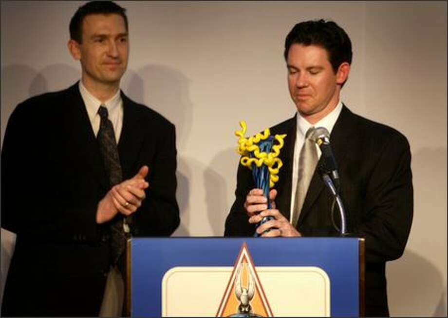 Mark Loretta of the Boston Red Sox accepts the Hutch Award from former Mariner John Olerud during the P-I Sports Star of the Year Awards banquet. Photo: Joshua Trujillo/Seattle Post-Intelligencer