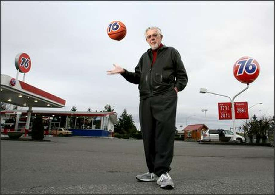 A Save the 76 Ball campaign aims to preserve the former gas station mainstay, designed by Ray Pedersen. Pedersen, who lives in Bellingham, first displayed his creation at the 1962 Seattle World's Fair. Pedersen gases up at this station in Tulalip, coincidentally one of the last gas stations in the U.S. with one of the icons. Photo: Scott Eklund/Seattle Post-Intelligencer
