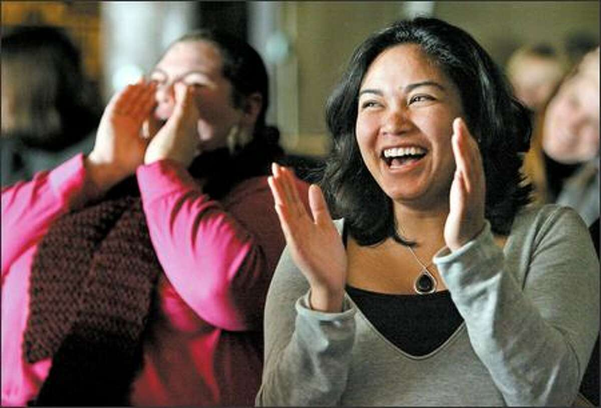 Mary Lawlon cheers and Chantra Siv claps during Non-Profit Night at the Comedy Underground. The events raised $14,000 for non-profits in 2006.