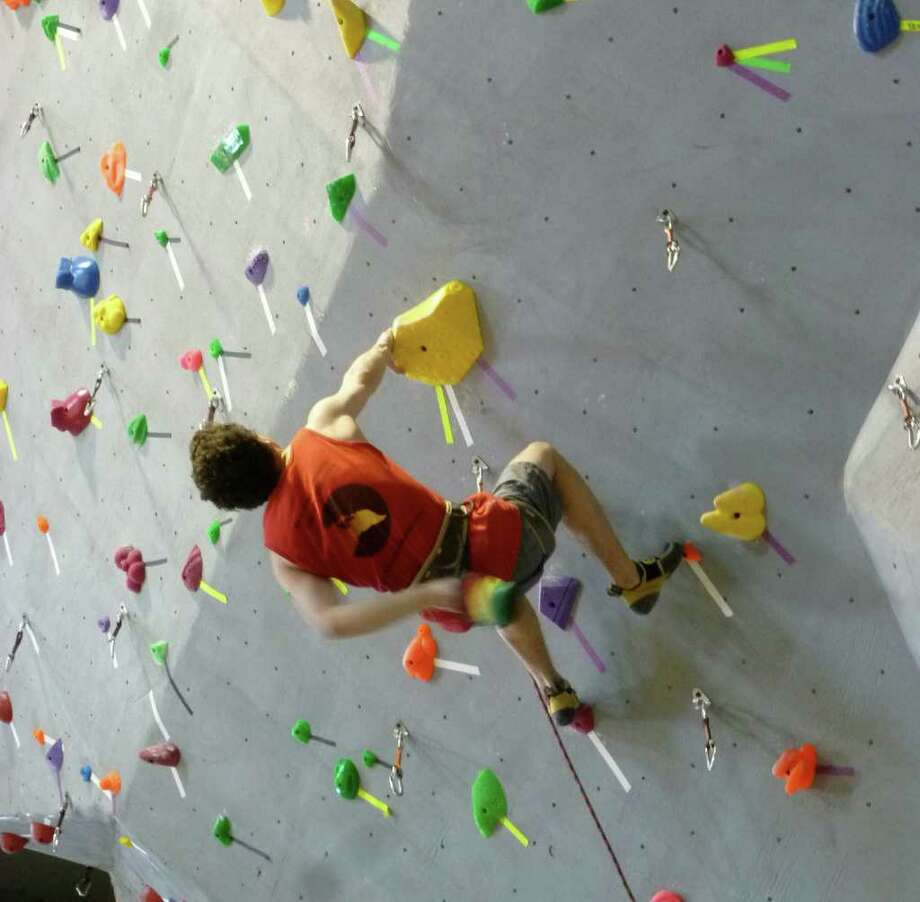 "Augy Cohn, 18, is nearly horizontal as he scales a 5.11-rated climb, one of the more challenging ""rock"" faces at Caribiner Indoor Climbing in Fairfield, which on Saturday hosted a USAC Sport Climbing Competition. Photo: Contributed Photo/Mike Lauterborn / Fairfield Citizen contributed"