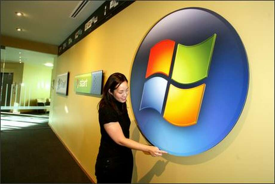 "Jenny Lam, creative director for Windows User Experience, adjusts an oversized version of the Windows Vista ""Start"" button -- which no longer says ""Start."" Photo: Scott Eklund/Seattle Post-Intelligencer"