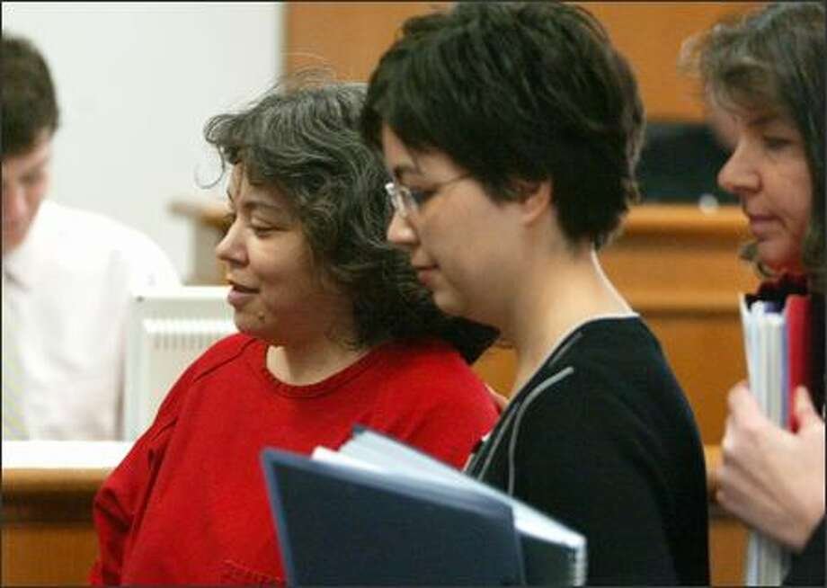 Murder charges against Marie Robinson, left, in the deaths of her two children were dismissed Wednesday on the grounds that she is mentally incompetent to stand trial. She is led from the courtroom by her attorneys Lisa Mulligan, center, and Colleen O'Connor. Photo: Paul Joseph Brown/Seattle Post-Intelligencer