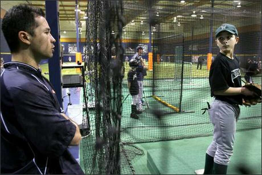 Jim Parque gives some tips to Mitchell Ciotta, 11, of Federal Way at Parque's Big League Edge baseball training facility in Auburn. Photo: Meryl Schenker/Seattle Post-Intelligencer