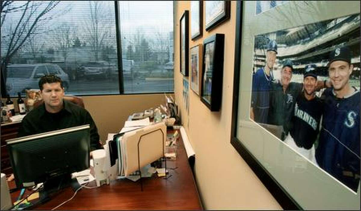 Edgar Martinez works in his office at Branded Solutions by Edgar Martinez in Redmond, a company that's an outgrowth of a family embroidery business.