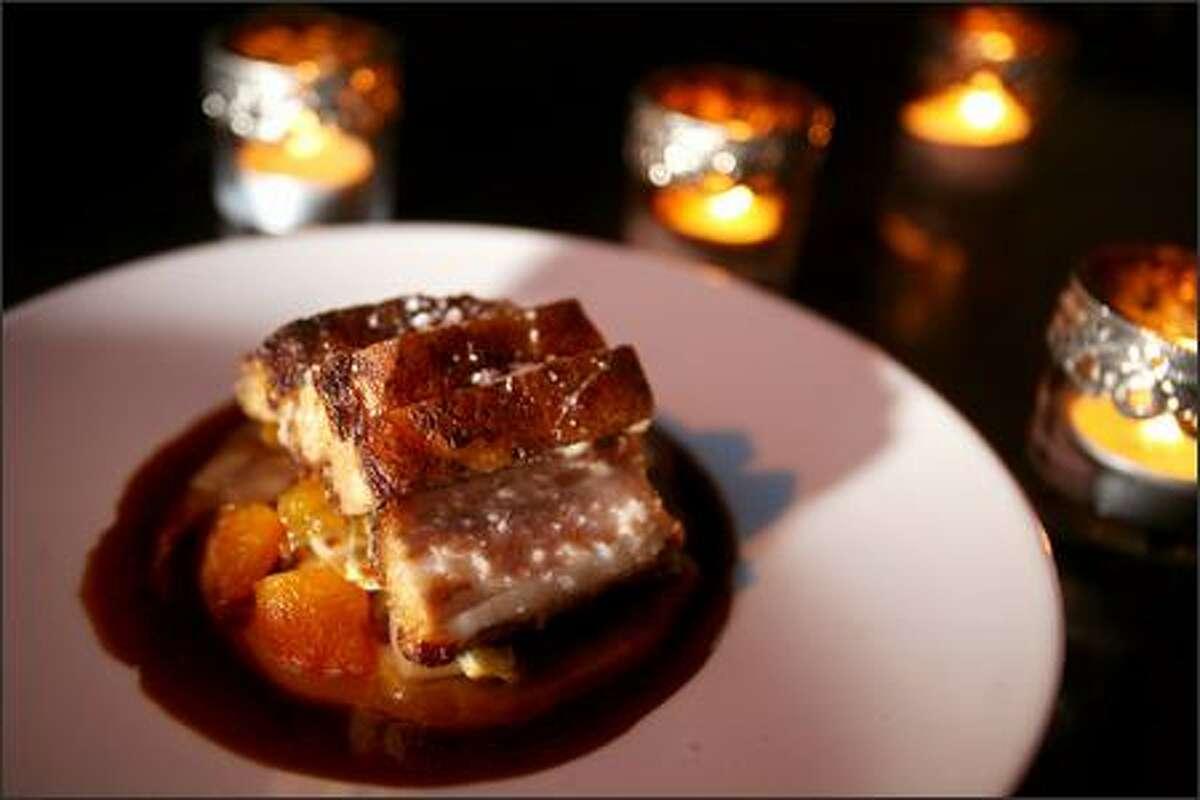 Restaurant Zoe's braised Kurobuta pork belly with caramelized endive puree, apricots and pistachios.