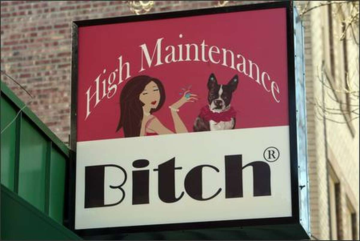 """High Maintenance Bitch's prominent sign has drawn some complaints. """"Wallingford is not like that,"""" one person says."""