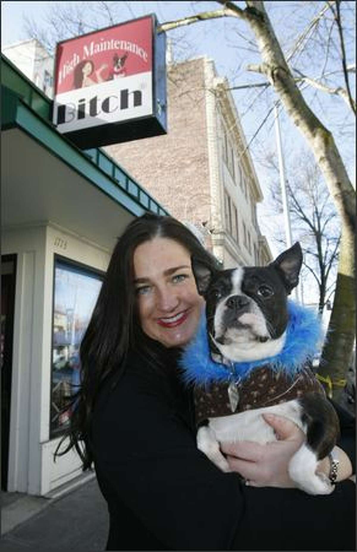 It all began five years ago, when Boston terrier Lola inspired Lori Pacchiano and her brother to make pet feather boas in their grandmother's North Seattle garage.