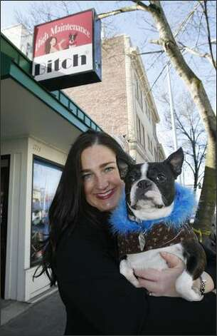 It all began five years ago, when Boston terrier Lola inspired Lori Pacchiano and her brother to make pet feather boas in their grandmother's North Seattle garage. Photo: Gilbert W. Arias/Seattle Post-Intelligencer