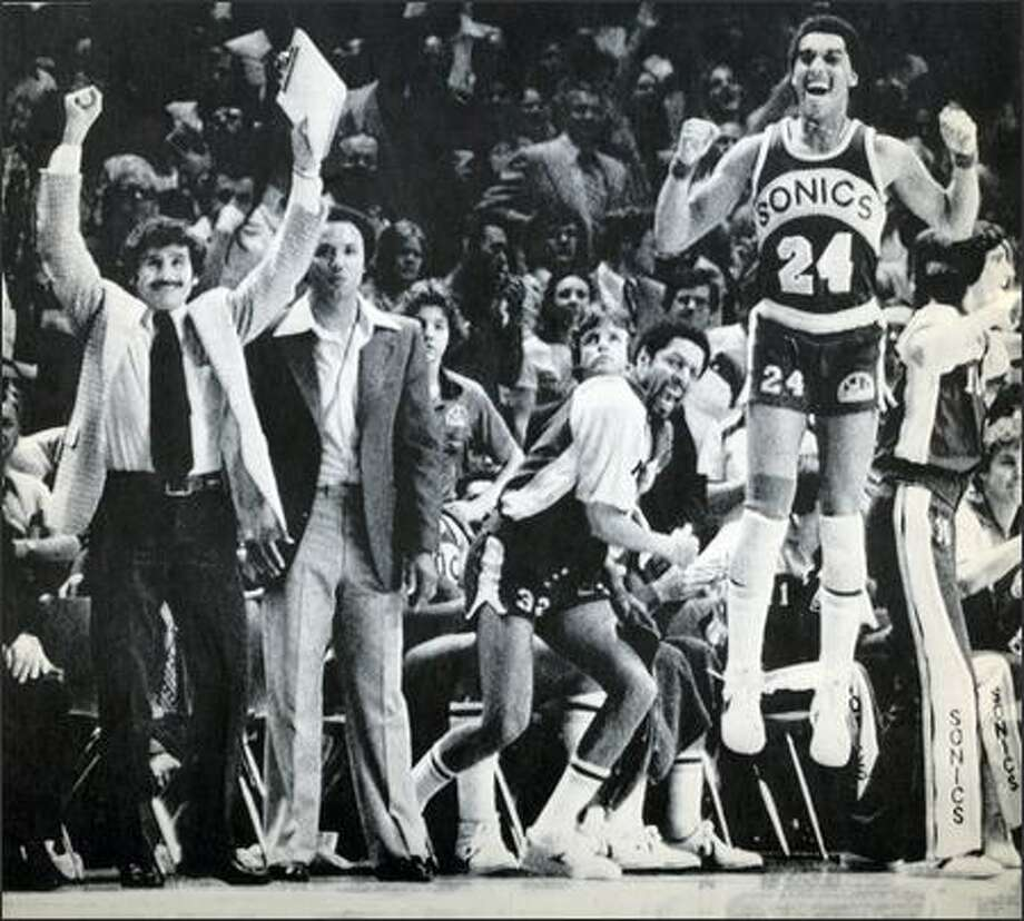 Dennis Johnson, right, joins in the Sonics' 1979 NBA title celebration. Former Sonics head coach Lenny Wilkens stands second from left. Photo: /Seattle Post-Intelligencer