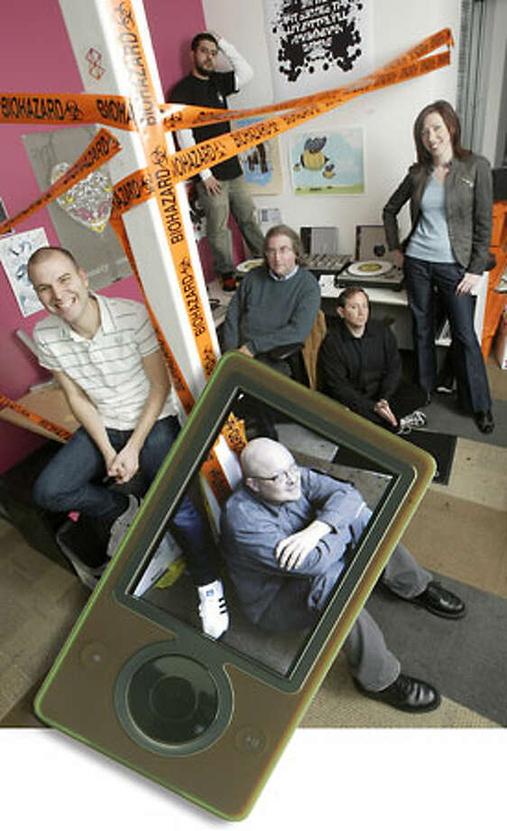 Zune Marketplace editorial team: Paul Pearson, in Zune. Behind him, from left, Kyle Hopkins, Omid Fatemi, Jon Kertzer, Andy Kessler and Emily Griffin. Photo: Andy Rogers/Seattle Post-Intelligencer