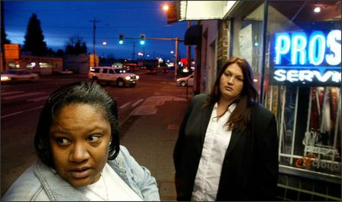 Social worker and ex-prostitute Nature Carter-Gooding, left, walks Aurora Avenue North to offer prostitutes help giving up the life. With her is recruit Tomi Whittington.