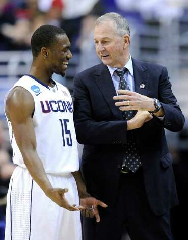 Connecticut head coach Jim Calhoun talks with guard Kemba Walker during the first half of the West Regional third-round NCAA tournament college basketball game against Cincinnati, Saturday, March 19, 2011, at the Verizon Center in Washington.  (AP Photo/Nick Wass) Photo: AP