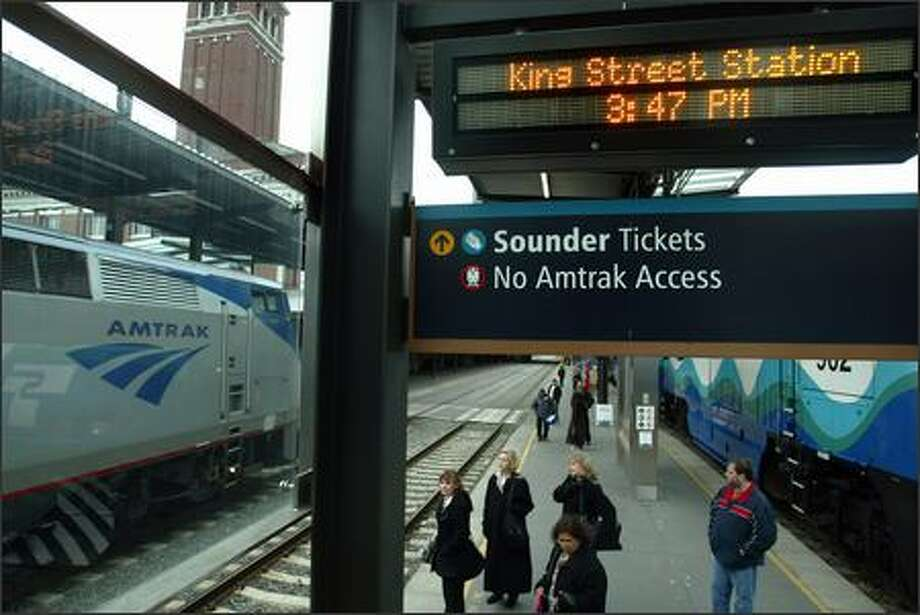 Passengers were full of praise for the Amtrak train service that arrived on time from Portland on Tuesday. The longer runs, however, are a constant source of frustration. Photo: Paul Joseph Brown/Seattle Post-Intelligencer