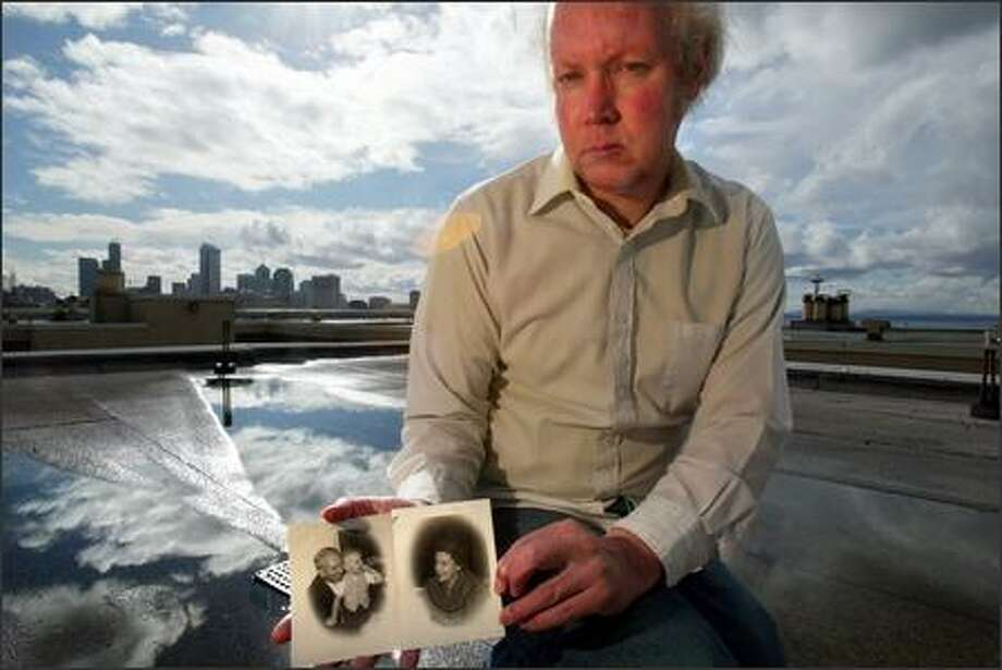Monte Wright holds pictures of himself as a child with his grandparents Monte and Gladys McCaughey on the roof of his Capitol Hill apartment. Wright's grandparents were killed after their house was set on fire by an arsonist March 6, 1987. The case remains unsolved. Photo: Karen Ducey/Seattle Post-Intelligencer