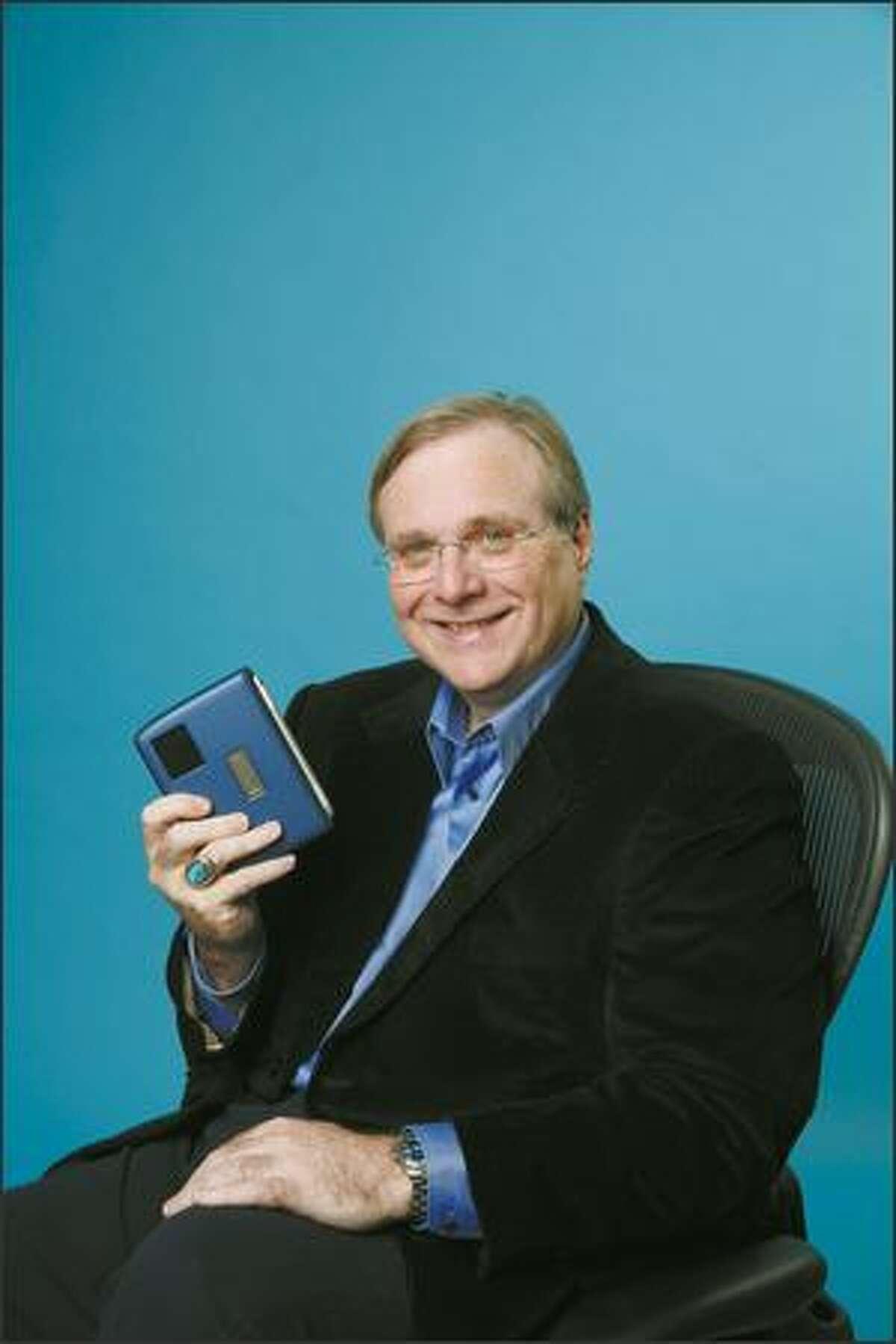 Paul Allen holding FlipStart.