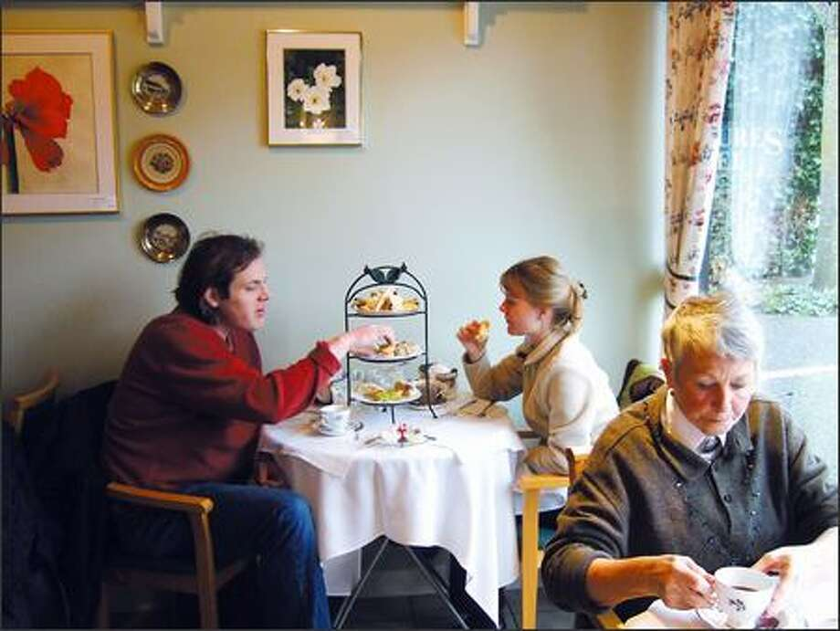 Scott and Andrea Corwin of Seattle enjoy the Big Muckle Tea at the White Heather Tea Room. One of their goals for visiting Victoria was to find a good spot for afternoon tea. Photo: SIMON CAPET