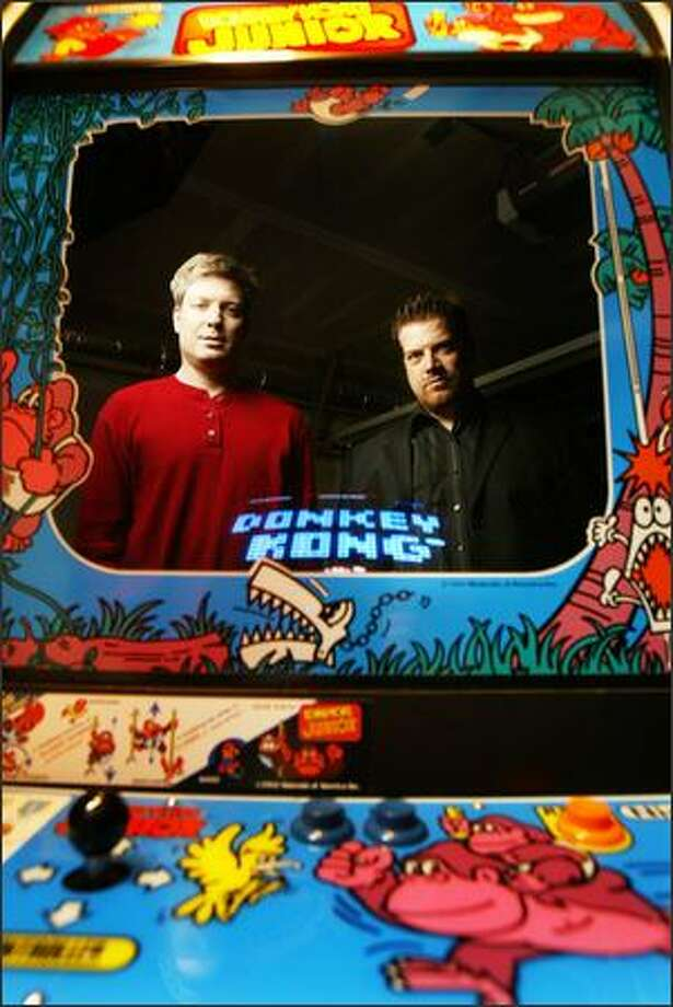 Childhood friends Steve Wiebe, left, and Mike Thompson made a movie about Wiebe's attempts to set the world record on Donkey Kong. Photo: Joshua Trujillo/Seattle Post-Intelligencer