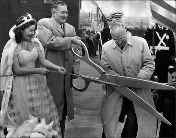 Seafair Queen Iris Adams and Mayor Allan Pomeroy celebrate the opening of the viaduct. Photo: / P-I File