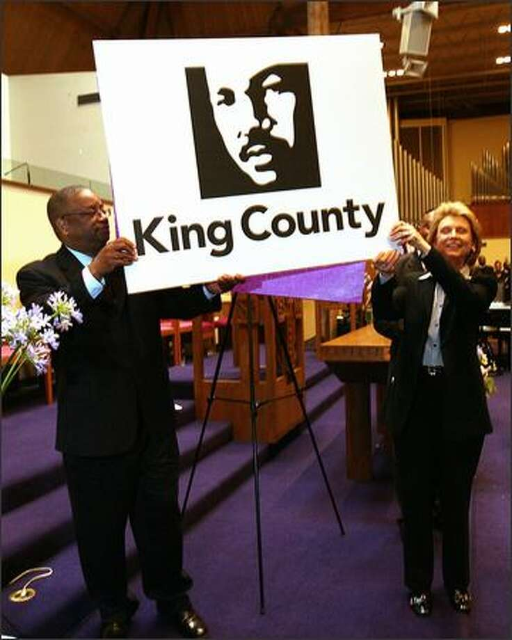 King County Council Chairman Larry Gossett and Gov. Chris Gregoire show the county's proposed logo of the Rev. Martin Luther King Jr. outside Mount Zion Baptist Church in Seattle on Sunday. Photo: Grant M. Haller/Seattle Post-Intelligencer