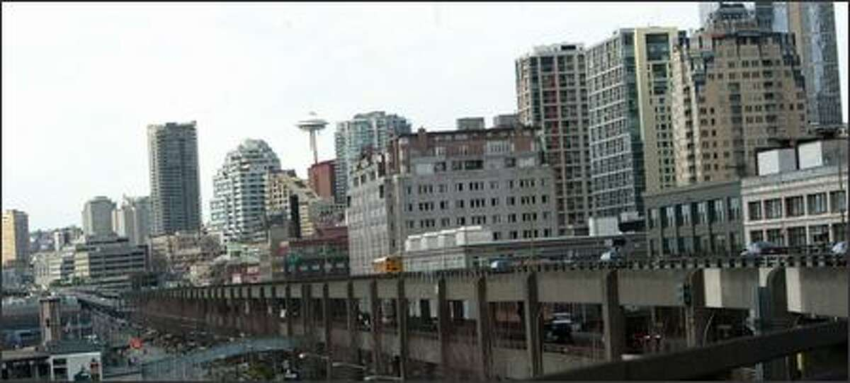 The Alaskan Way Viaduct runs past downtown Seattle, with the Space Needle visible to the north.
