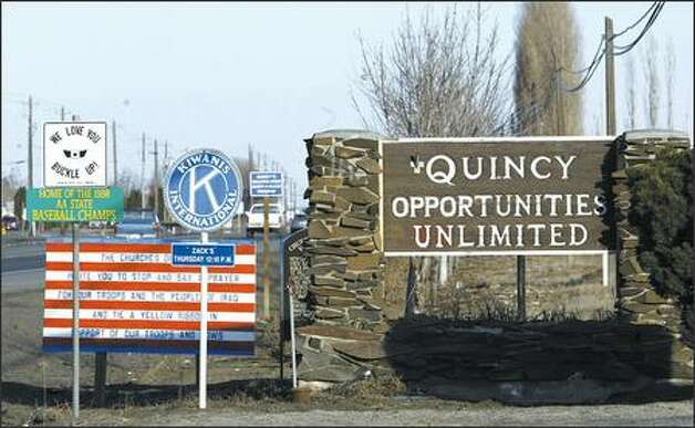 Once more inspirational than anything, Quincy's slogan is rapidly becoming reality, as Microsoft, Yahoo and Intuit build technology facilities in the quiet agricultural community and houses go up. Photo: Andy Rogers/Seattle Post-Intelligencer