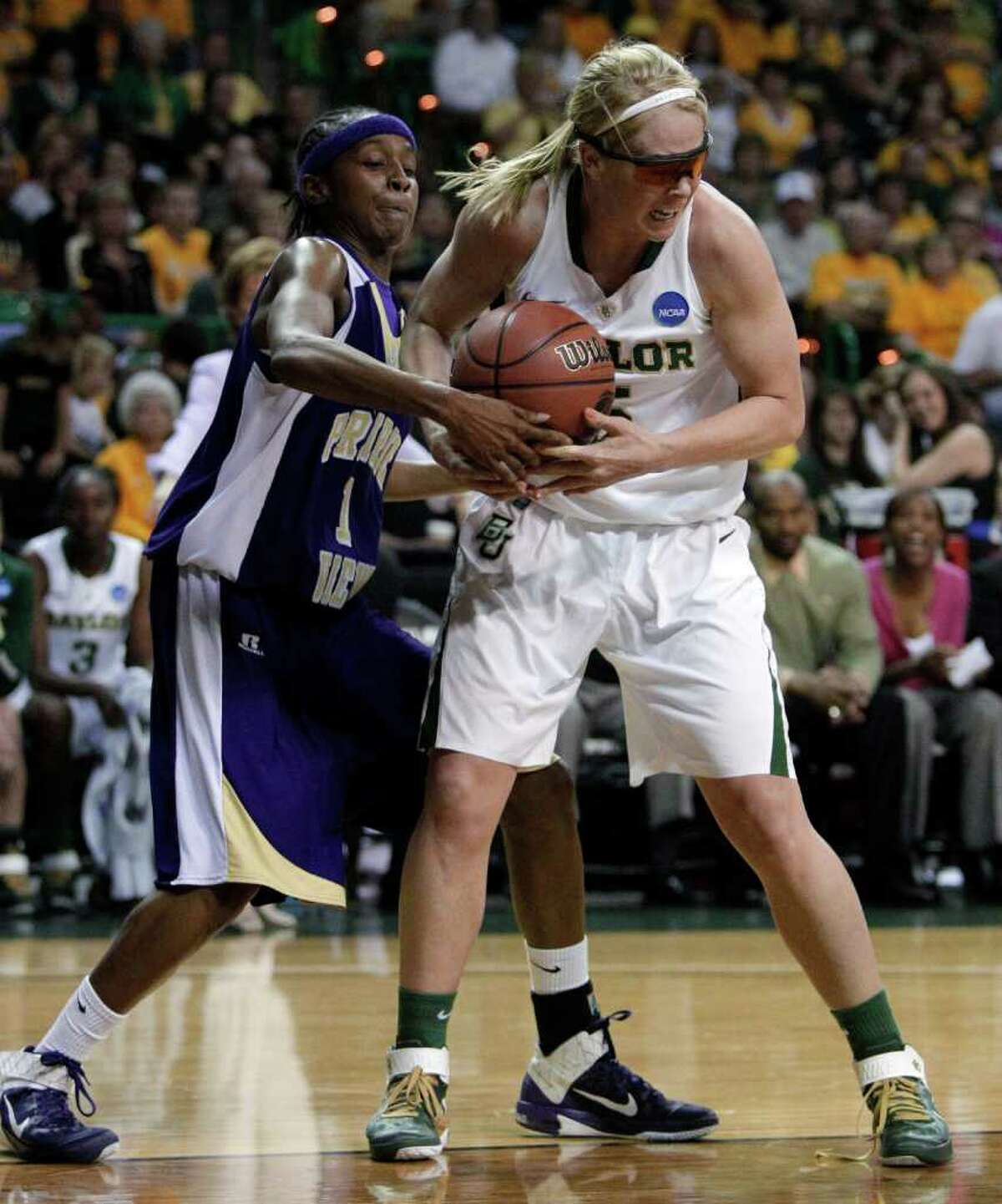 Baylor guard Melissa Jones (5) comes down with a defensive rebound against Prairie View A&M guard Dominique Smith (1) in the first half of a first-round game of the NCAA women's college basketball tournament, Sunday, March 20, 2011, in Waco, Texas. Baylor won 66-30.