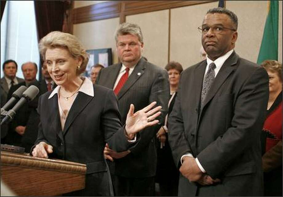 Gov. Chris Gregoire, Seattle Mayor Greg Nickels and King County Executive Ron Sims meet the media Wednesday in Olympia. They will begin $915 million in non-controversial work on the viaduct. Photo: / Associated Press