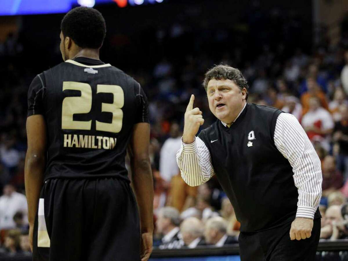 Oakland, Mich. head coach Greg Kampe, right, gestures to Reggie Hamilton in the first half of a West Regional NCAA tournament second round college basketball game against Texas, Friday, March 18, 2011 in Tulsa, Okla. Texas won 85-81.