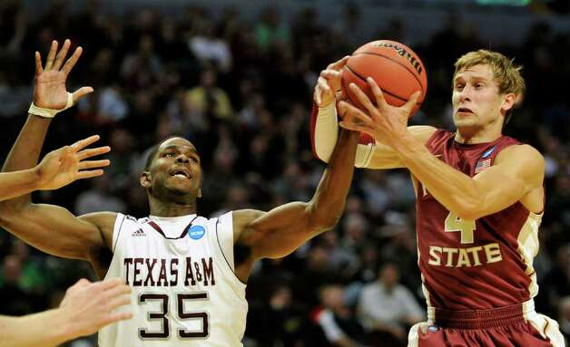 Texas A&M's Ray Turner (35) and Florida State's Deividas Dulkys (4) of Lithuania go for a loose ball in the first half of a second-round NCAA Southwest Regional tournament college basketball game in Chicago, Friday, March 18, 2011. (AP Photo/Jim Prisching) Photo: AP Photo/Charles Rex Arbogast
