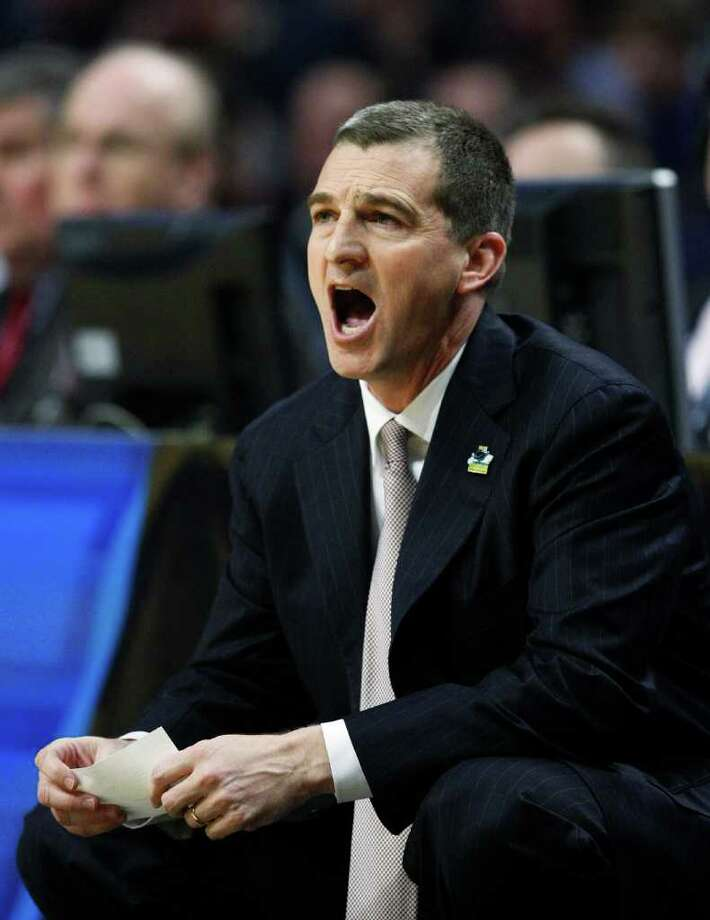 Texas A&M head coach Mark Turgeon yells out to his team in the first half of a second-round NCAA Southwest Regional tournament college basketball game in Chicago, Friday, March 18, 2011. Florida State won 57-50. Photo: AP Photo/Charles Rex Arbogast