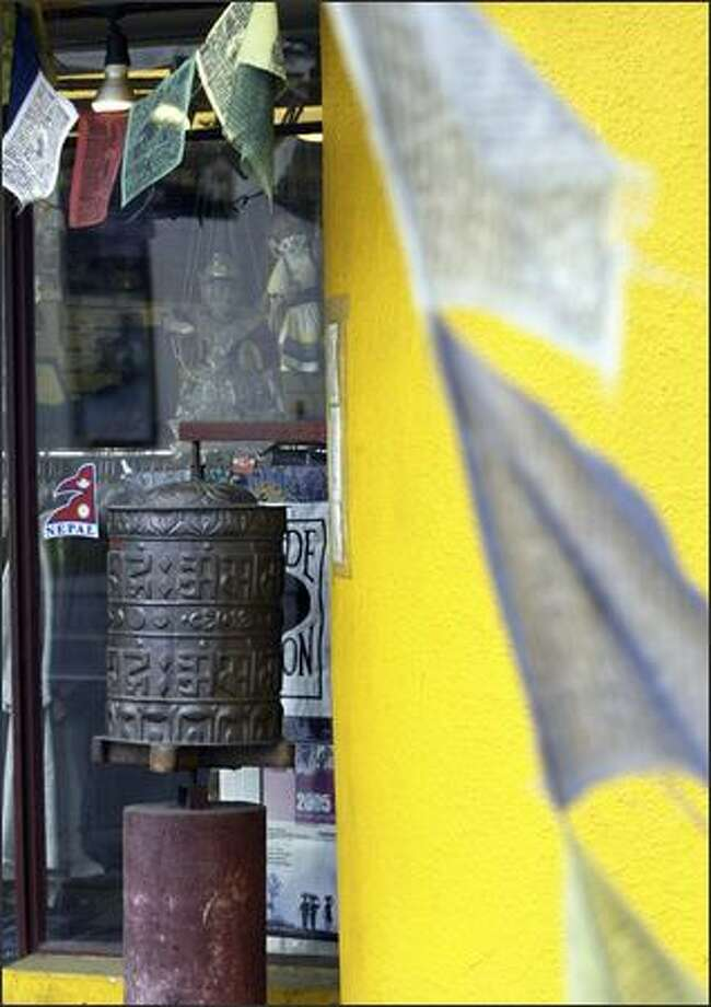 A prayer wheel identical to this one is missing at Planet Earth Yoga Center in Fremont. Photo: Andy Rogers/Seattle Post-Intelligencer