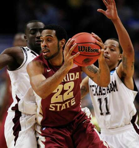 Florida State's Derwin Kitchen (22) is defended by Texas A&M's Andrew Darko, left, and B.J. Holmes (11 ) in the second half of a second-round NCAA Southwest Regional tournament college basketball game in Chicago, Friday, March 18, 2011. Kitchen was high scorer for Florida State with 15 points in their 57-50 win. Photo: AP Photo/Charles Rex Arbogast