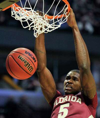 Florida State's Bernard James (5) slam dunks against Texas A&M in the second half of a second-round NCAA Southwest Regional tournament college basketball game in Chicago, Friday, March 18, 2011. (AP Photo/Jim Prisching) Photo: AP Photo/Charles Rex Arbogast