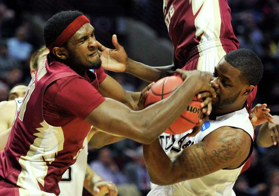 Florida State's Chris Singleton, left, and Texas A&M's Kourtney Roberson fight for a loose ball in the first half of a second-round NCAA Southwest Regional tournament college basketball game in Chicago, Friday, March 18, 2011. (AP Photo/Jim Prisching) Photo: AP Photo/Charles Rex Arbogast