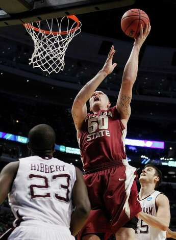 Florida State's Jon Kreft (50) puts up a shot between Texas A&M defenders Naji Hibbert (23) and Nathan Walkup in the first half of a second-round NCAA Southwest Regional tournament college basketball game in Chicago, Friday, March 18, 2011. Photo: AP Photo/Charles Rex Arbogast