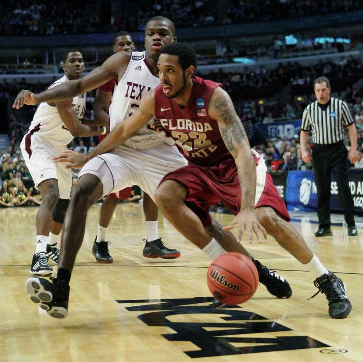 Florida State's Derwin Kitchen (22) drives around Texas A&M's Naji Hibbert in the first half of a second-round NCAA Southwest Regional tournament college basketball game in Chicago, Friday, March 18, 2011.