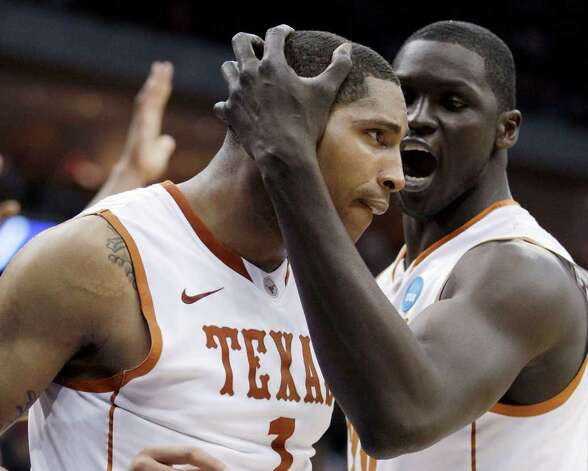 After Texas' Gary Johnson, left, scored on an offensive rebound, he receives congratulations from Alexis Wangmene during the second half against Arizona in a West Regional NCAA tournament third-round college basketball game Sunday, March 20, 2011, in Tulsa, Okla. Photo: AP Photo/Charlie Riedel