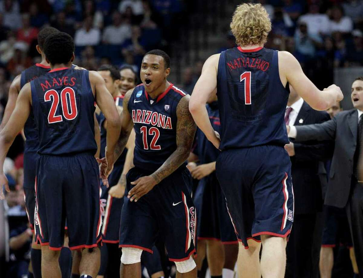From left, Arizona's Jordin Mayes, Lamont Jones and Kyryl Natyazhko react during a break in play in the first half against Texas in a West Regional NCAA tournament third-round college basketball game Sunday, March 20, 2011, in Tulsa, Okla.