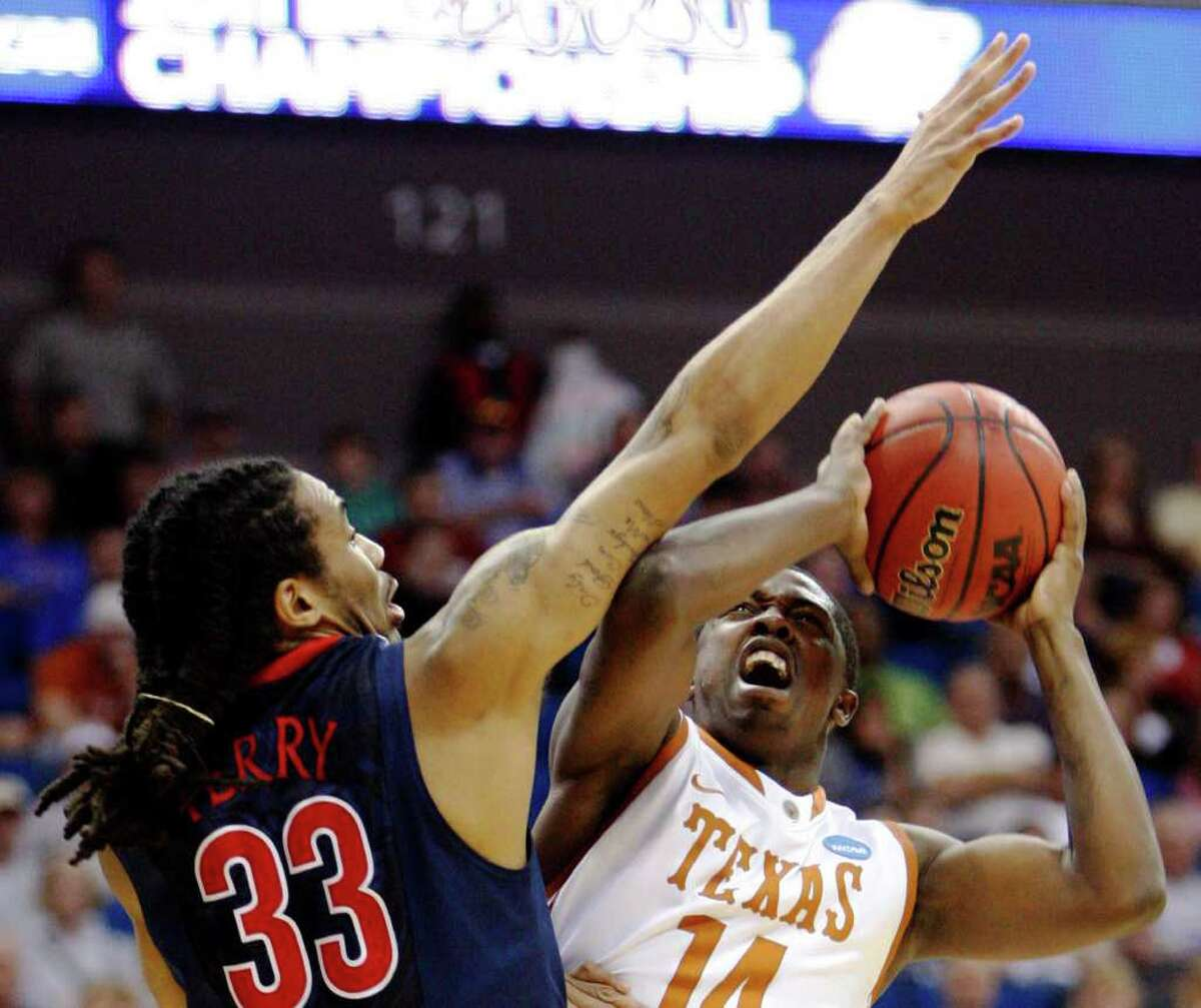 Texas' J'Covan Brown shoots as Arizona's Jesse Perry defends during the first half of a West regional NCAA tournament third-round college basketball game Sunday, March 20, 2011, in Tulsa, Okla. (AP Photo/Sue Ogrocki)