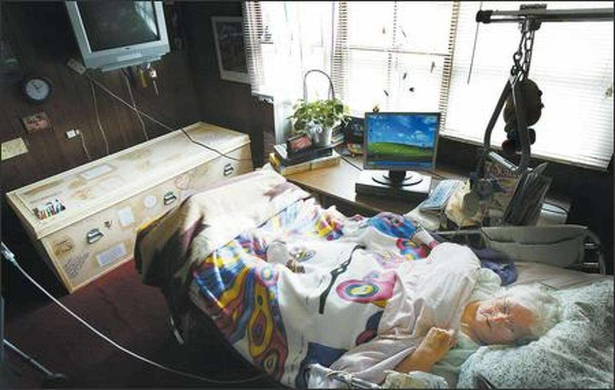 Doris Jean Powers, 85, lies in her bed at her Renton home while at the foot of the bed sits her handmade coffin. Powers, who has a heart condition and is likely to die soon, has taken an active role in planning her own funeral, which will take place at the home she shares with her family, instead of at a funeral home.
